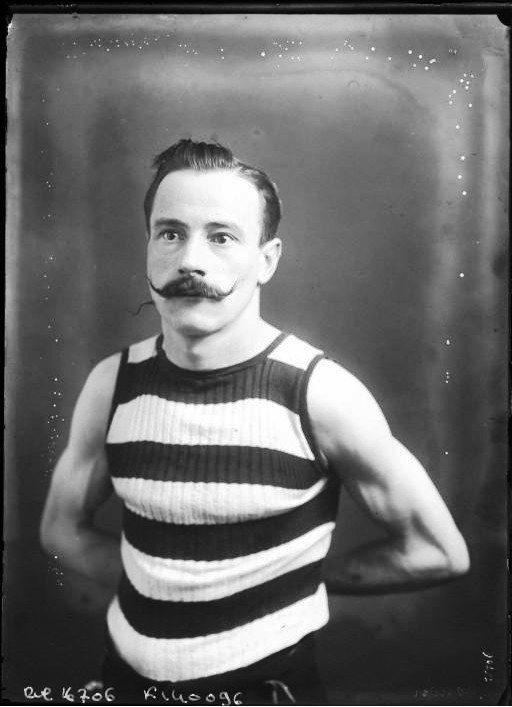 Portrait - Face - Photo - French - Striped tank top and handlebar moustache