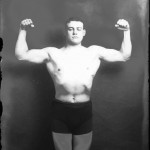 Portrait  - Photo - French Boxer Flexing Muscles