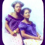 Portrait - Photo - Two women in purple blouses