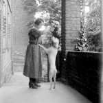 Portrait - Photo - Woman teaching dog a trick